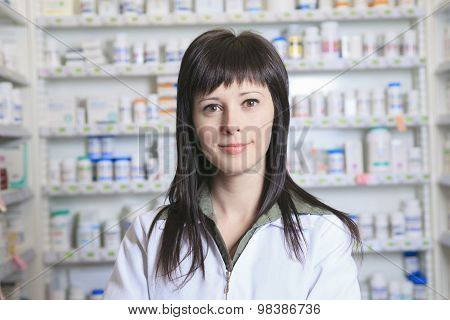Woman pharmacist at the pharmacy place