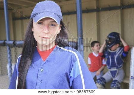 A baseball instructor with player on the background