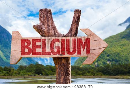 Belgium wooden sign with landscape background