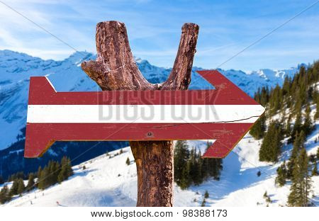 Latvia Flag wooden sign with winter background