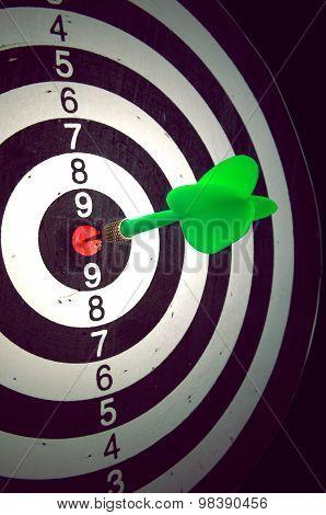 Dart In Darts Target Against A Dark Background