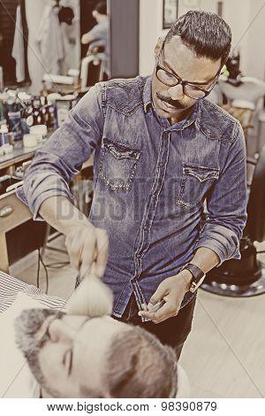 Barber Brushing Beard.