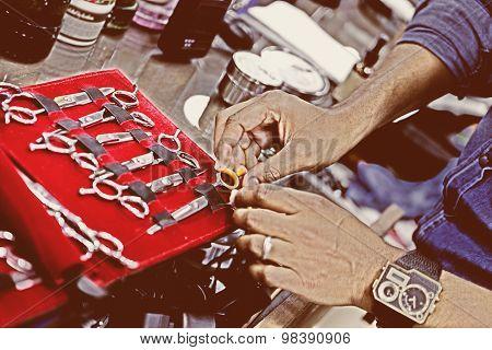 Barber Choosing Scissors