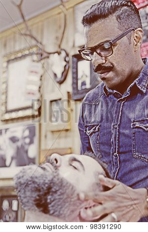 Barber Massaging Beard.