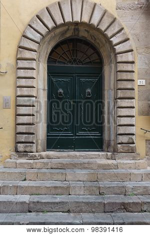 Old Arched Door With Stone Surround
