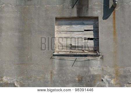 Old Boarded Up Window In A Concrete Wall