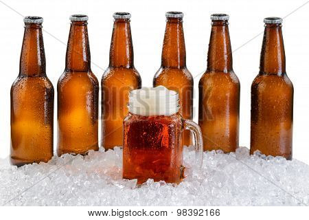 Glass Of Beer With Six Pack Of Ice Cold Bottles Isolated On White Background