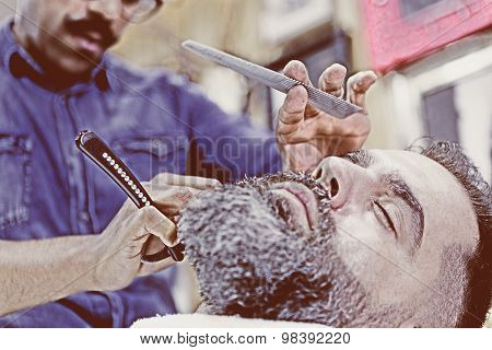 Customer On A Beard Shaving Session.