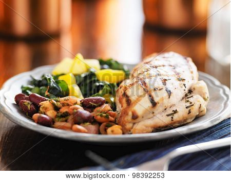 grilled chicken breast with kale and mango salad