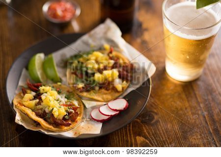 authentic street tacos and beer on plate with copy space
