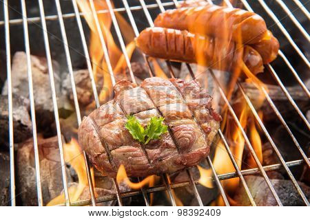 Bbq Meat Steak And Sausages On The Grill