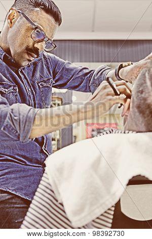 Hairstylist Shaving A Beard With A Razor.