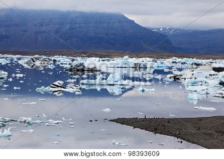 Iceland in July. Icebergs and ice floes in the Ice Lagoon Yokulsarlon