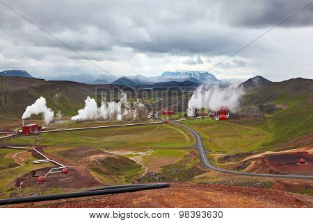 Krafla Lake neighborhood. Summer Iceland. Steam rises above the hot ground
