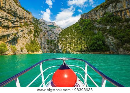Travel to Provence. Azure water of the river Verdon. Pleasure boat with the red lantern