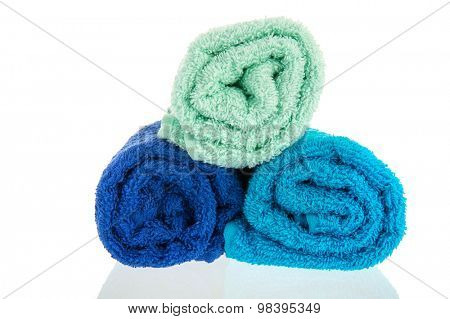 Blue rolled towels isolated over white background