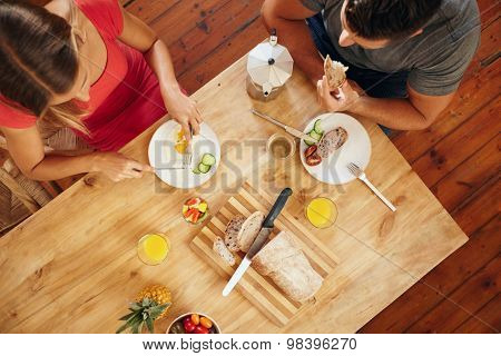 Couple Enjoying A Healthy Morning Breakfast In Kitchen