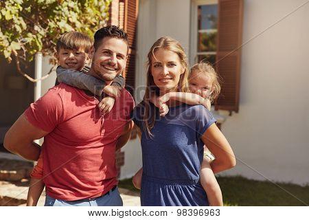Family Having Fun In Backyard Together
