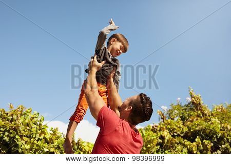 Happy Father And Son Having Fun Outdoors