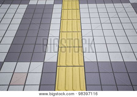 Yellow Color Blind Floor Tiles On Public Walkway