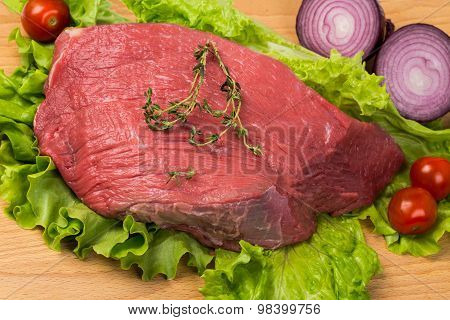 Pice Of Fresh Raw Meat With Vegetables