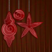 pic of stippling  - holiday ornament shapes in shades of shiny red on a rich brown backdrop  - JPG