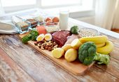 Постер, плакат: balanced diet cooking culinary and food concept close up of vegetables fruit and meat on wooden