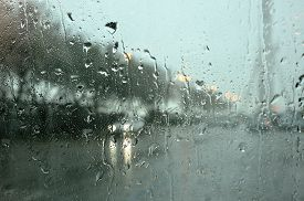 stock photo of rainy weather  - car in town in a rainy day - JPG