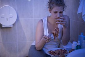picture of bulimic  - Image of depressed girl eating out of control - JPG
