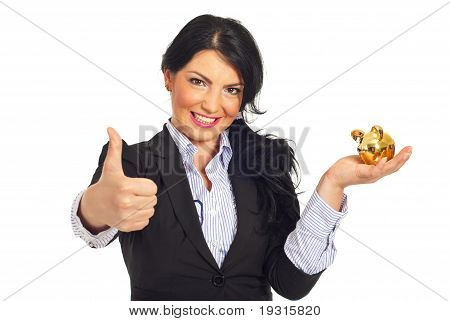 Successful Business Woman With Piggy Bank