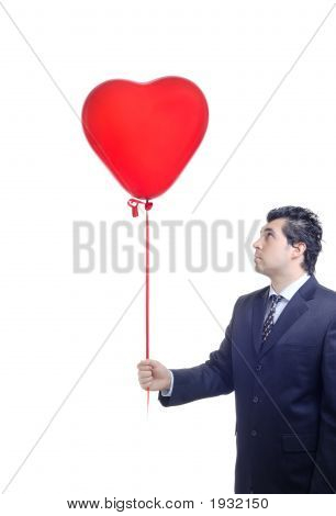 Man Holding A Red Heart-Shaped Balloon