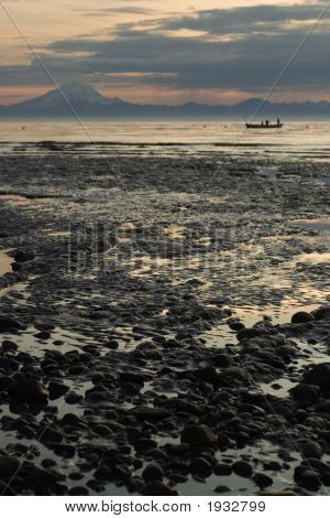 Cook Inlet Low Tide Beach With Fisherman Boat And Volcanoe In Background
