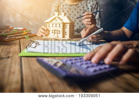 Woman Calculating House Tax Financial