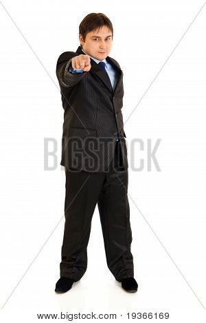 Full length portrait of smiling businessman pointing finger at you isolated on white