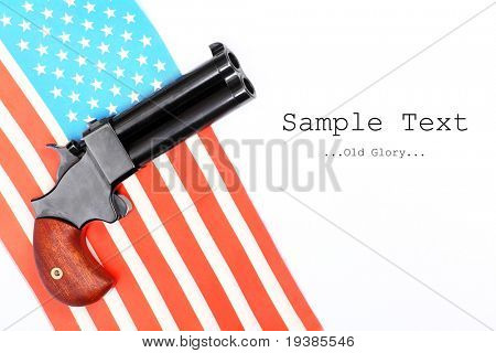 An 2 shot .45 cal percussion derringer hand gun. Conceptual image, independence metaphor.