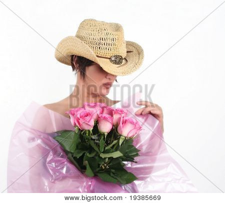 A girl with a dozen pink roses on a white background