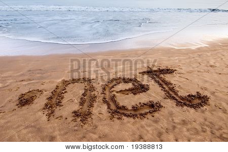 dot net written on sand near the sea