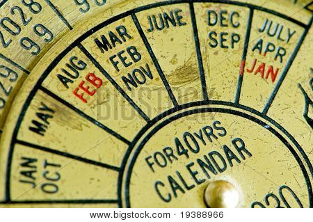an antique calendar detail macro shot