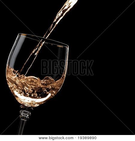 Alcohol drink pours into the glass. Blank space on the right