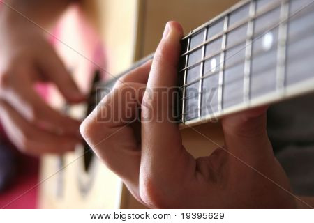 Hands with a guitar