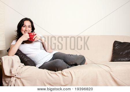 Woman With Drink On Couch