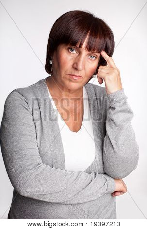 Sadness mature woman. Isolated on gray