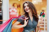 Attractive Girl In Shopping Mall With Bags poster