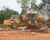 picture of oversize load  - bucket loader loading hauler - JPG