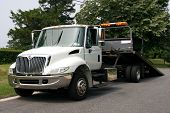 image of towing  - A white flatbed tow truck for towing  - JPG