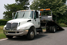 foto of towing  - A white flatbed tow truck for towing  - JPG
