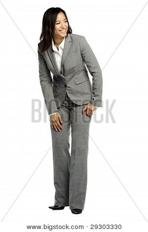 Asian Business Woman Smiling And Looking To Side
