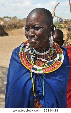 OLDUVAI GORGE, TANZANIA, DECEMBER 23, 2011, OLDER MAASAI  WOMAN STANDS PROUD AND SMILES