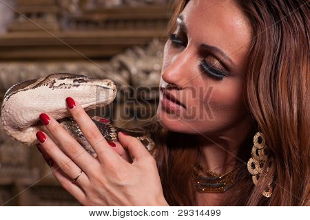 Young Beautiful Woman With Snake