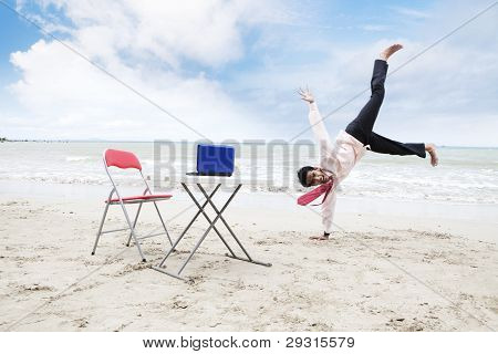 Happy Asian Businessman at Beach